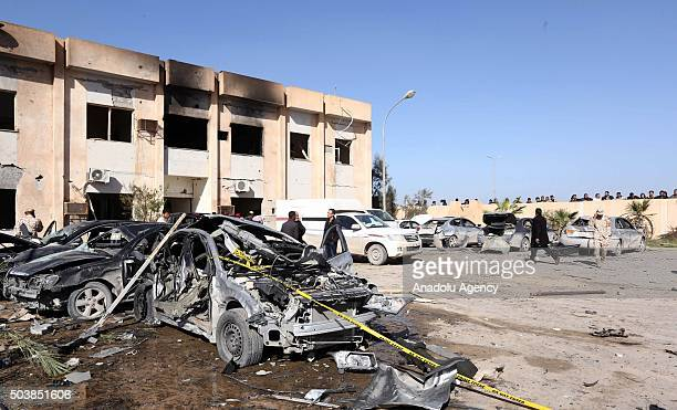 Damaged cars are seen after a truck bomb attack targeting a police training center in Zliten Libya on January 7 2016