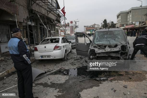 Damaged cars are seen after rockets fired from across the border landed in Turkeys Reyhanli district in southern Hatay province of Turkey on January...