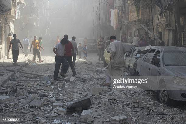 Damaged cars are seen after the Syrian army attacked the oppositioncontrolled Meshed neighborhood of Aleppo Syria on August 15 2015