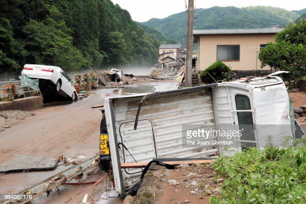 Damaged cars are seen as the area was inundated after Tsubogawa River flooding after heavy rain on July 8 2018 in Seki Gifu Japan At least 81 people...