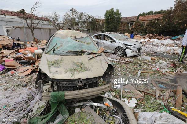 TOPSHOT Damaged cars are seen at the site of an explosion in Ningbo in China's eastern Zhejiang province on November 26 2017 A major explosion hit...