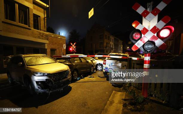 Damaged cars are seen in Belgium's Dinant after heavy rain and floods caused major damage on July 24, 2021.