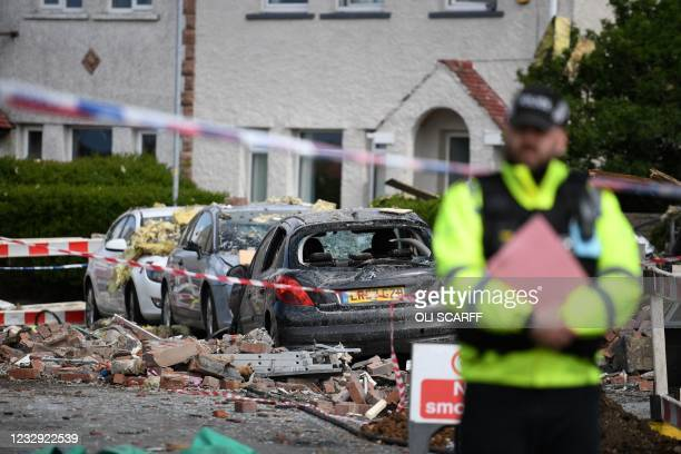 Damaged cars are seen inside a police cordon, set up in a street in the town of Heysham in north-west England, the site of an overnight gas explosion...
