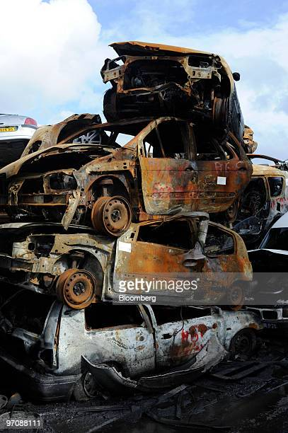 Damaged cars are seen stacked at Allo Casse Auto's car demolition site in Athis Mons France on Wednesday Feb 24 2010 French consumer spending...