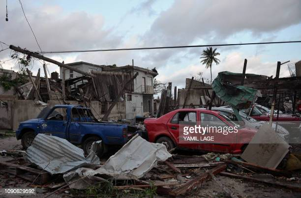 Damaged cars flattened by debris from a building are seen in Havana after the passage of a tornado on January 28 2019 A rare and powerful tornado...
