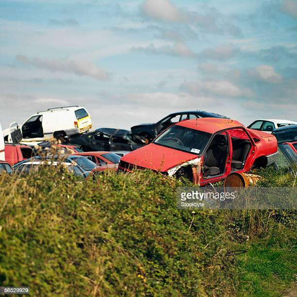damaged cars in a junkyard