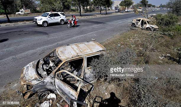 Damaged Cars on National Highway 1 at Murthal town after Jat protests for reservation in government services turned violent on February 23 2016 in...