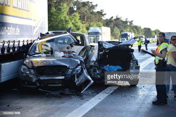 Damaged cars on the Autobahn 6 motorway near Viernheim Germany 9 June 2017 Police say two people died and nine others were seriously injured in a...