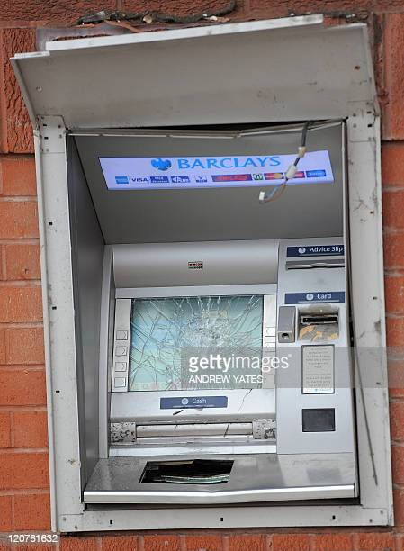 A damaged cash machine is pictured at a Barclays Bank branch in Handsworth Birmingham central England on August 9 following a third night of violence...