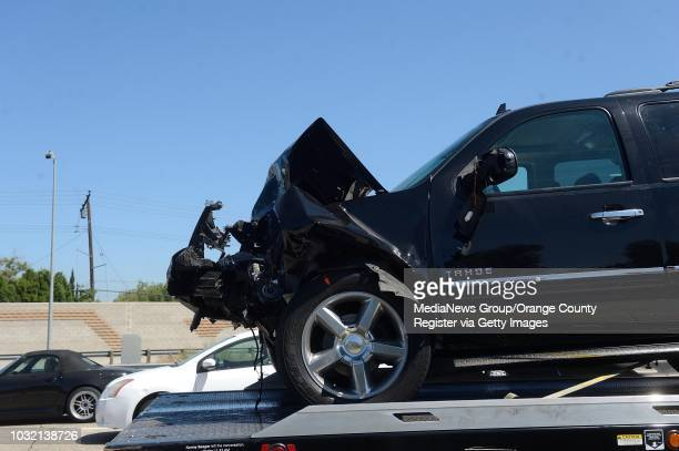 A damaged Chevy Tahoe sits on tow truck after a collision in the HOV lane on the northbound 405/22 Freeway in Seal Beach after a fatal traffic...