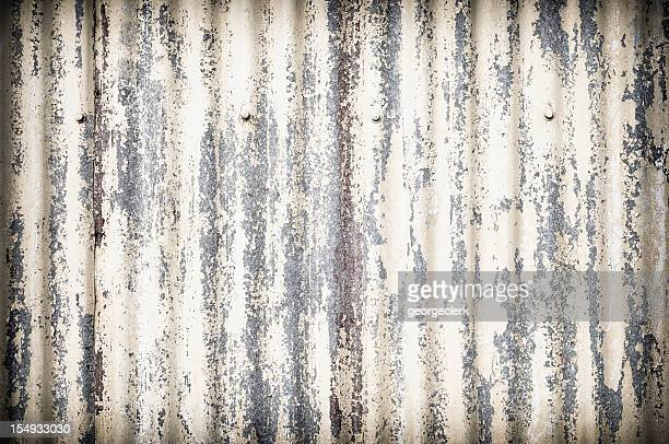 damaged corrugated metal surface background - corrugated iron stock photos and pictures
