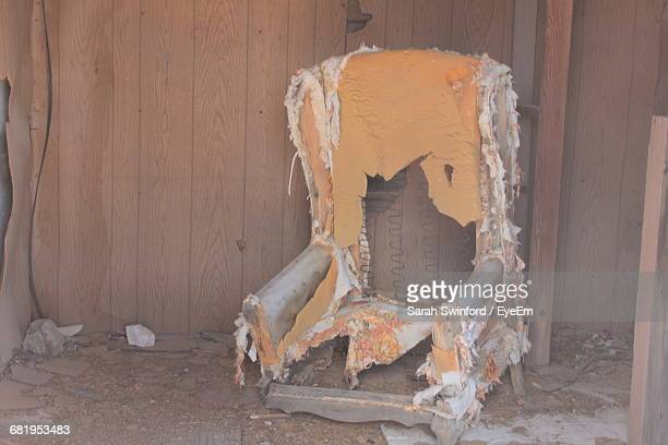 damaged couch in abandoned home - degeneration stock photos and pictures