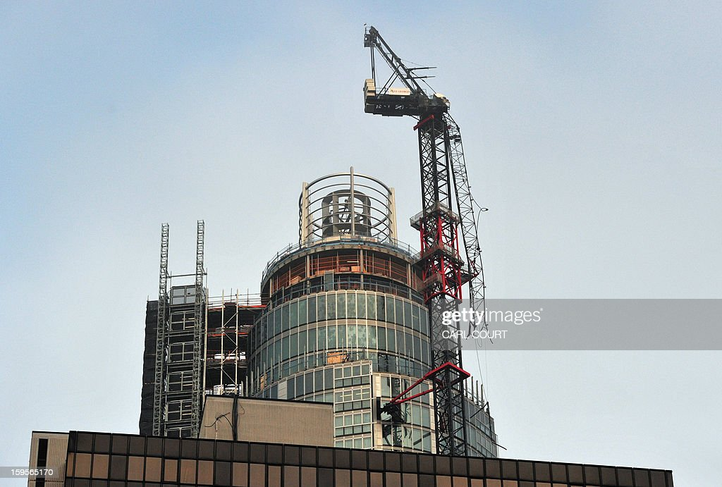 A damaged crane that was hit by a helicopter is pictured following the crash in central London on January 16, 2013. Two people were killed after a helicopter hit a crane at a building site and plunged to the ground in a ball of flames, police said.
