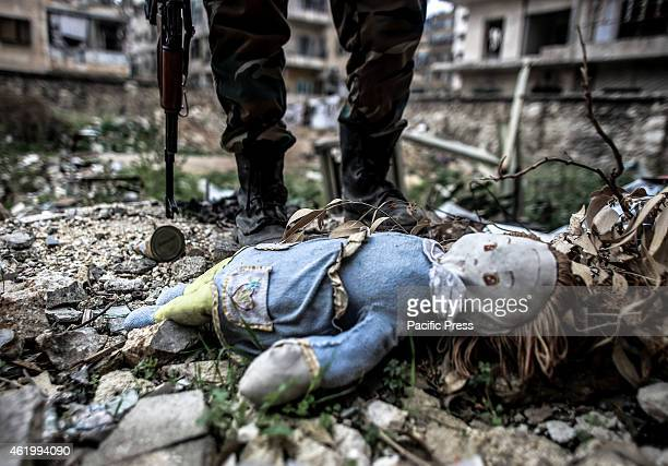 Damaged doll seen in Bustan alQasr Aleppo where AlQaeda were fighting with alAssad's army elements in the front line