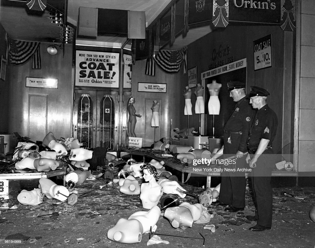 Damaged dummies are strewn outside this wrecked store in West 125th St. on August 2, 1943 in Harlem, New York. Broken plate glass windows helped to run property damage figures into the millions. A 10:30 curfew was enforced last night. Dimout was suspended in that area.