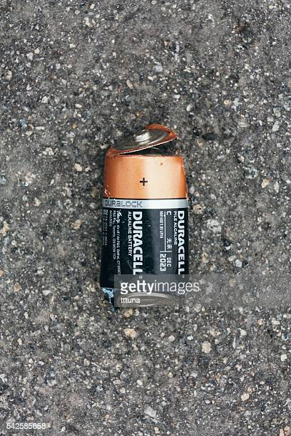 Damaged Duracell battery on street
