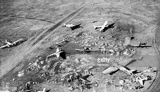 Damaged enemy aircraft and workshops at derna Aerodrome This picture shows how the aerodrome looked after RAF had visited it January 1942