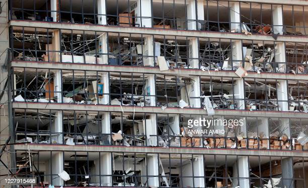 TOPSHOT A damaged facade is seen following yesterday's blast at the port of Lebanon's capital Beirut on August 5 2020 Rescuers worked through the...