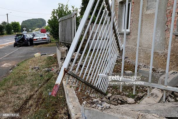 A damaged fence and wall of a house are pictured at the Chaussée de Damery road in the commune of Vauciennes near Epernay northeastern France on...