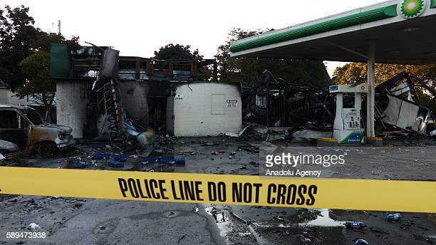 A damaged gas station is seen after citizens of Milwaukee set fire to several vehicles gas station and shops in Wisconsin Milwaukee USA on August 14...