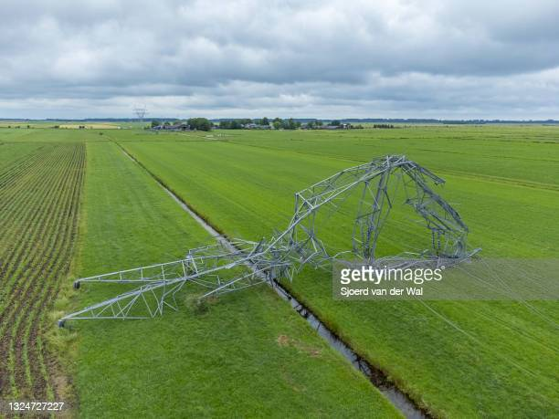 Damaged high voltage electricity pylons after a after a heavy summer thunderstorm with downwind that took place on Friday evening June 18,...
