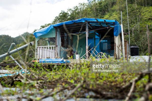 Damaged home from hurricane Maria at La 26 community in Comerío PR on March 1 2017 The town located in the mountainous area of the island it is still...