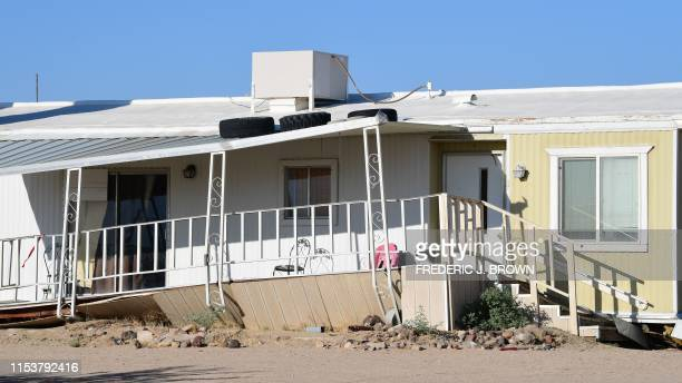 TOPSHOT A damaged home is seen after a 64magnitude earthquake hit in Ridgecrest California on July 4 2019 Southern California was rocked by a...