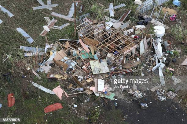 A damaged home is seen as people deal with the aftermath of Hurricane Maria on September 25 2017 in Toa Baja Puerto Rico Maria left widespread damage...