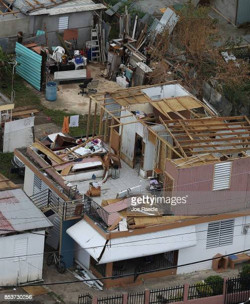 Damaged home is seen as people deal with the aftermath of Hurricane Maria on September 25, 2017 in Levittown, Puerto Rico. Maria inflicted widespread...