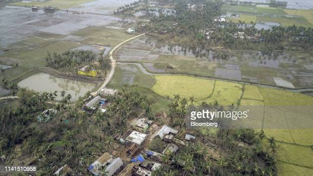 Damaged homes and agricultural fields stand in this aerial photograph taken above Puri Odisha India on Sunday May 5 2019 Authorities launched a...