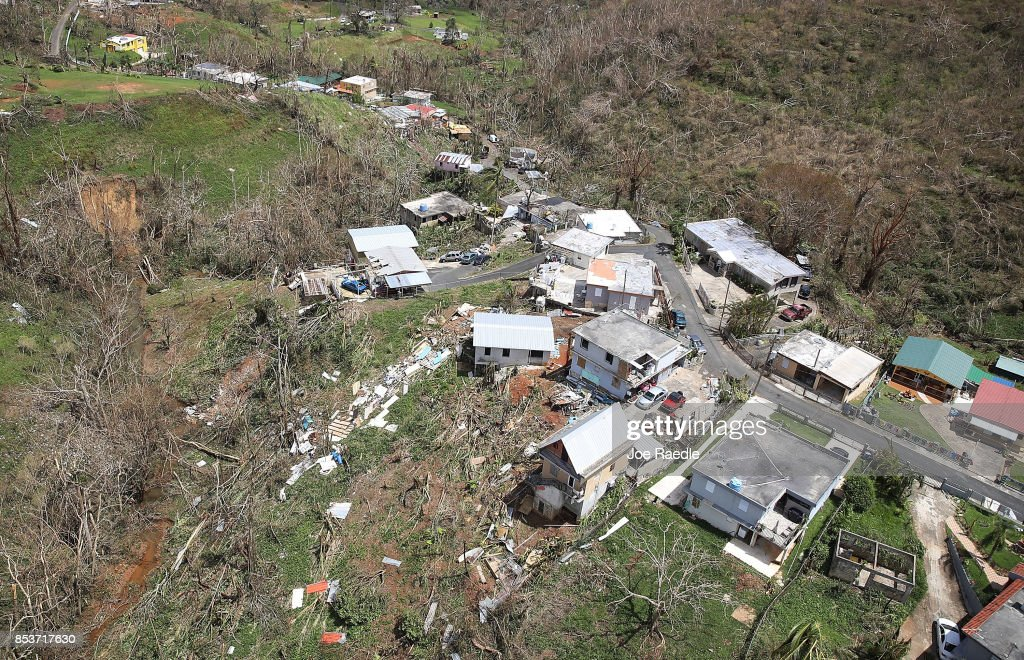 Damaged homes and downed trees are seen along a ridgeline as people deal with the aftermath of Hurricane Maria on September 25, 2017 in Corozal, Puerto Rico. Maria left widespread damage across Puerto Rico, with virtually the whole island without power or cell service.