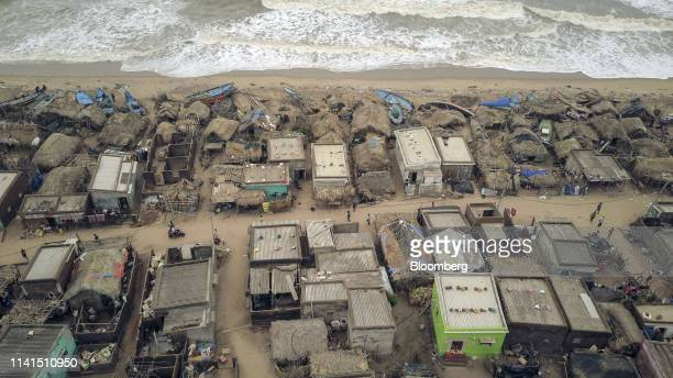 Damaged homes and fishing boats stand in this aerial photograph taken above Puri Odisha India on Sunday May 5 2019 Authorities launched a massive...
