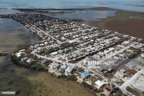 Damaged homes and streets littered with debris are seen after Hurricane Irma passed through the area on September 13 2017 in Summerland Key Florida...