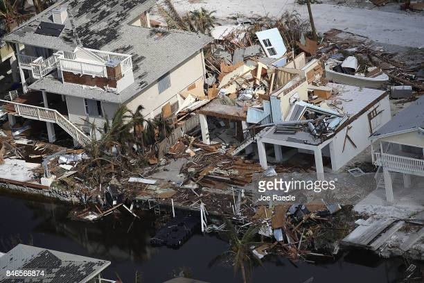 Damaged homes and streets littered with debris are seen after Hurricane Irma passed through the area on September 13 2017 in Ramrod Key Florida The...