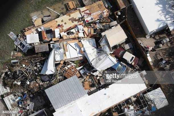 Damaged homes and streets littered with debris are seen after Hurricane Irma passed through the area on September 13 2017 in Key West Florida The...