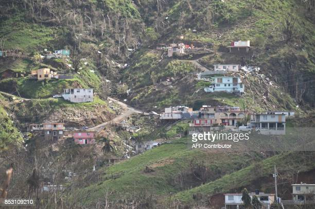 Damaged homes and vegetation during the passage of Hurricane Maria are viewed on a mountain in Naranjito southwest of San Juan Puerto Rico on...