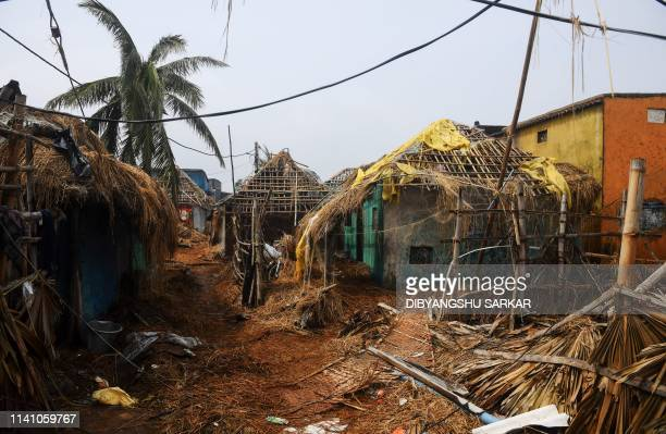Damaged homes are pictured near the seafront in Puri in the eastern Indian state of Odisha on May 4 after Cyclone Fani swept through the area Cyclone...