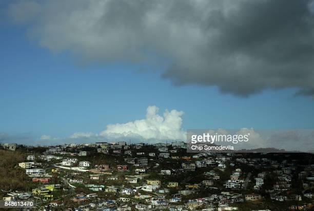 Damaged homes dot the hillside more than a week after Hurricane Irma made landfall September 17 2017 in Charlotte Amalie St Thomas US Virgin Islands...