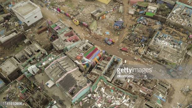 Damaged homes stand in this aerial photograph taken above Puri Odisha India on Sunday May 5 2019 Authorities launched a massive restorationandrelief...