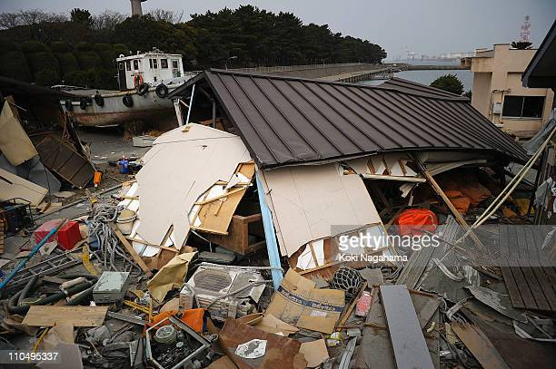 Damaged house and ships are washed away on March 20, 2011 in Kashima, Ibaraki, Japan. The 9.0 magnitude strong earthquake struck offshore on March 11...