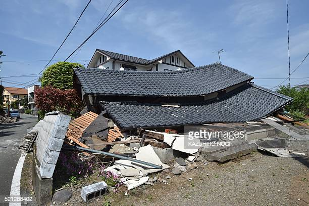 Damaged house is seen in the town of Mashiki, Kumamoto prefecture on April 15, 2016. A strong 6.5-magnitude earthquake hit Japan's southwestern...