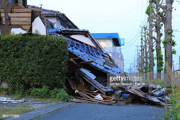 damaged house on road against sky - earthquake stock pictures, royalty-free photos & images
