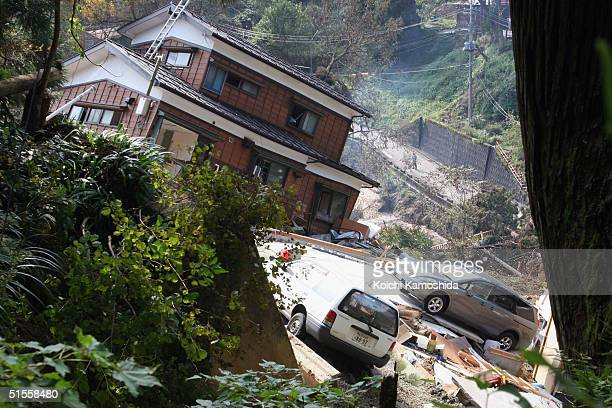 Damaged house sits precariously as earthquke aftershocks continue on October 25, 2004 in Nagaoka, Japan. A series of powerful earthquakes rocked...
