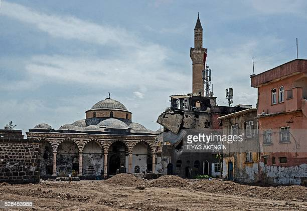 Damaged houses and a mosque are pictured in the historical district in Diyarbakir, southeastern Turkey, on May 5 following clashes between Turkish...