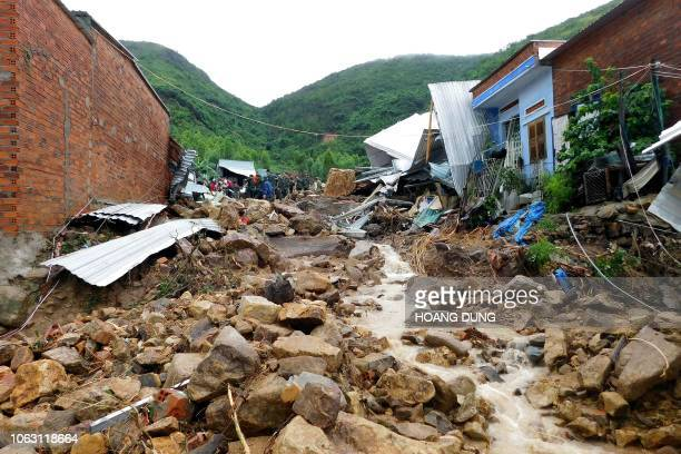 Damaged houses and debris are seen following flash floods and landslides in the Phuoc Dong commune of central Vietnam's Khanh Hoa province on...