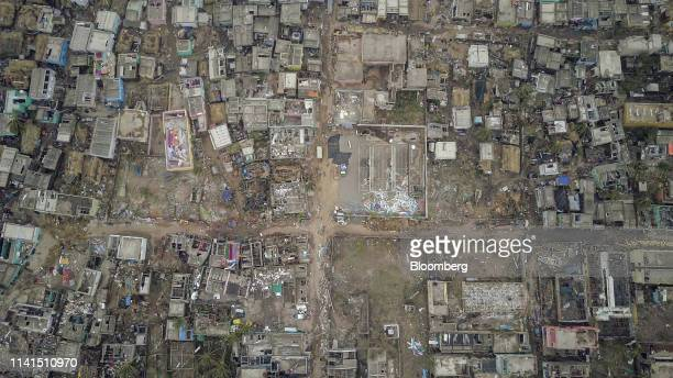 Damaged houses and debris stand in this aerial photograph taken above Penthakata Odisha India on Sunday May 5 2019 Authorities launched a massive...