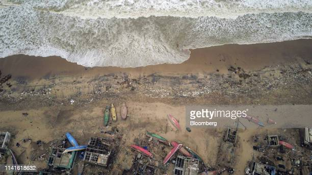 Damaged houses and grounded fishing boats stand along the coastline after Cyclone Fani passed in this aerial photograph taken in Bhuvan village in...