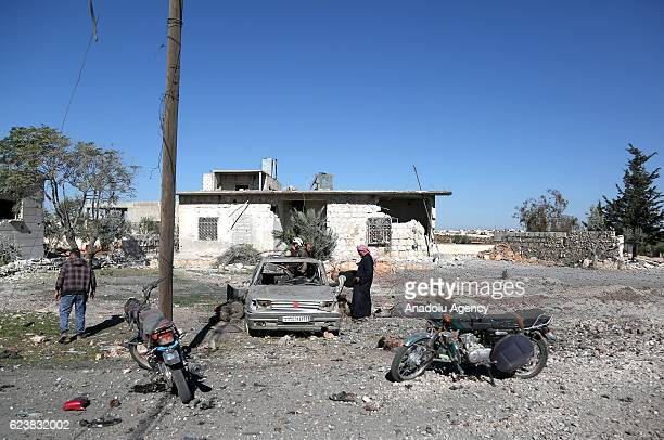 Damaged houses and vehicles are seen after the Assad Regime's and Russian forces' airstrikes over residential areas in Urm al-Kubra Town of Aleppo,...