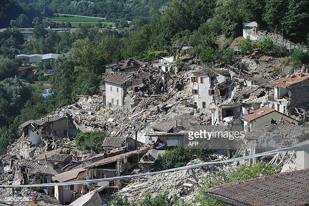 Damaged houses are pictured in Pescara del Tronto on August 25 a day after a 6.2-magnitude earthquake struck the region killing some 247 people. The...