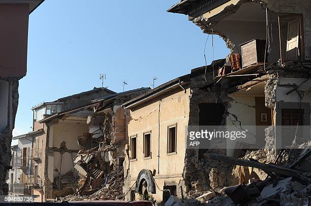 TOPSHOT Damaged houses are pictured in the central Italian village of Amatrice after a powerful earthquake rocked central Italy on August 24 2016 A...
